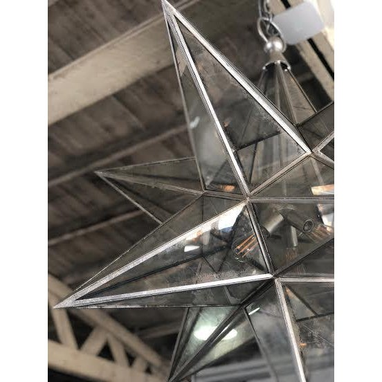 Made by E.F. Chapman for Visual Comfort. This 3D star form is made transluscent with smokey glass, giving a subtly...