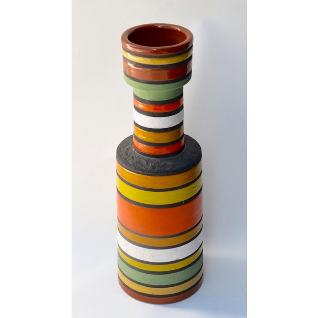 A striking vase with multicolor alternating horizontal bands of colored glazes with high gloss and matt by Aldo Londi by...