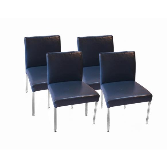 Incredibly well constructed leather, armless, low back, chairs by Brayton International. This exquisite set is crafted in...