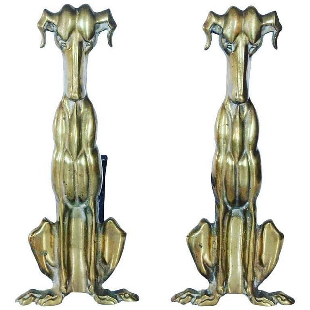 Art Deco brass dog andirons. They were made in Nashville TN.