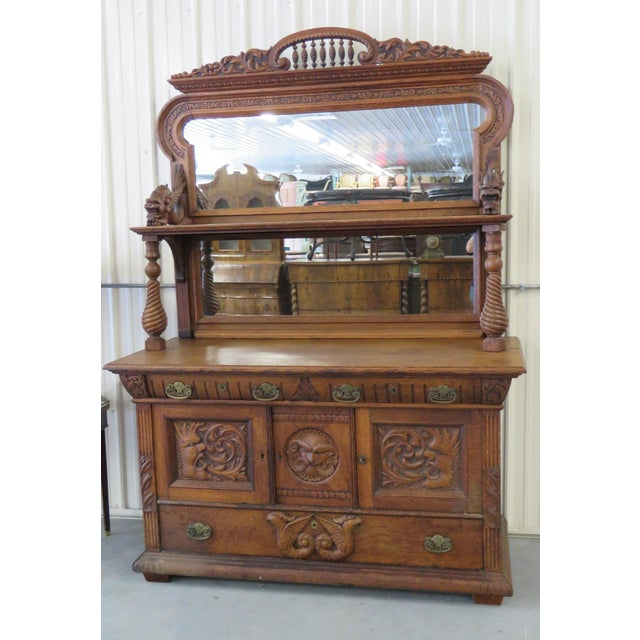 Renaissance style sideboard with mirrored superstructure and 2 drawers over 3 doors.