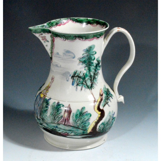 Salt-glazed Stoneware Cider Jug with Polychrome Decoration, Mid-18th Century. The jug is painted in colourful enamels with...