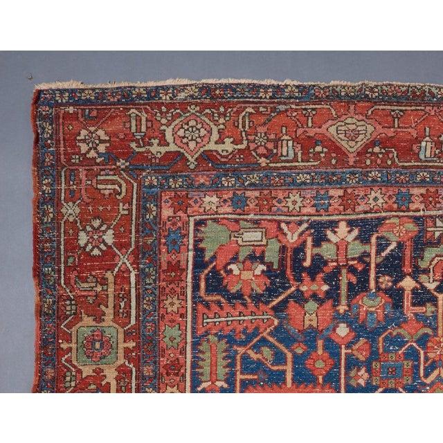 Heriz allover design blue ground carpet