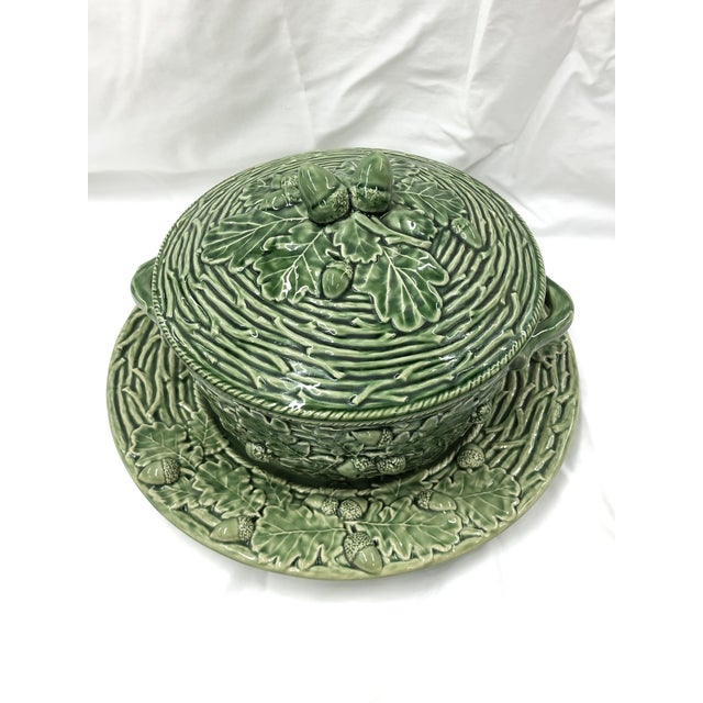 """Bordallo Pinherio acorns and leaves pattern covered tureen with under plate. Under plate measures 13.5""""D, tureen measures..."""