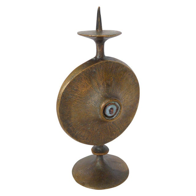 Heavy patinated bronze candleholder in the Brutalist style with enameled all-seeing eye in center.
