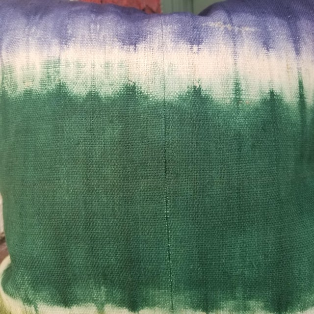 A tie dye pillow. Each pillow cover is of excellent quality and decorated and woven entirely by hand by the Miao hill...