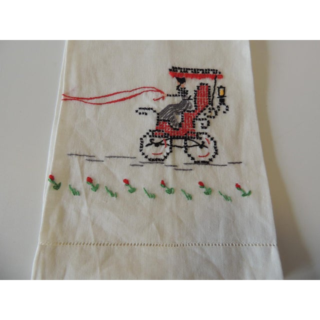 Vintage Green and Red Embroidered Bathroom Guest Towel Women riding a holiday carriage. 100% Cotton Size: 19 x 11 x 0.03