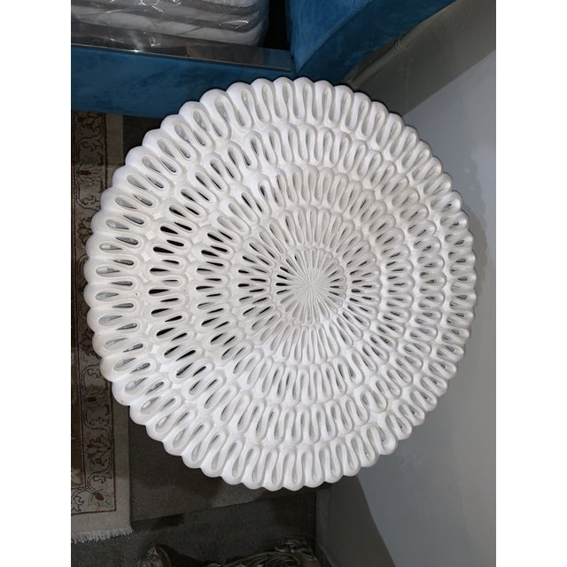 Oly Studio Pipa ribbon light resin side table. This piece has a time-less feel to it, plain white to match any color...