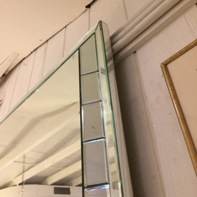 Very large impressive Mid-Century modern rectangular mirror having smaller bevelled rectangles around the periphery and a...