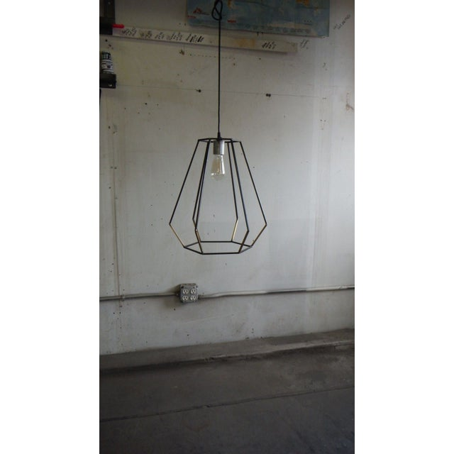 Hand made Vintage inspired ceiling pendant light with welded bronze joints. Traditional brass and modern steel are...