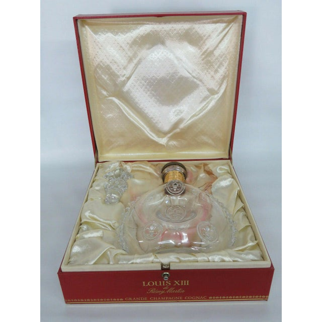 This gorgeous empty Remy Martin Louis XIII bottle includes the original box, cork stopper, and glass stopper, and is a...