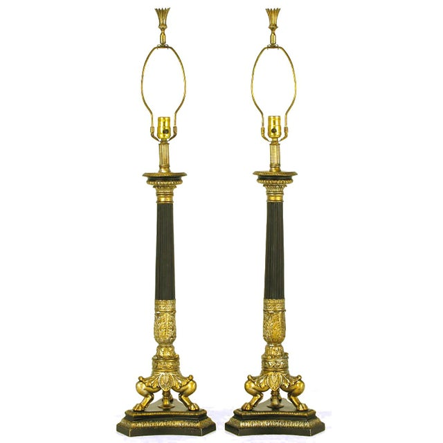 Empire revival table lamps with triple lions leg cast metal and gilt base and carved wood black lacquer and parcel gilt...