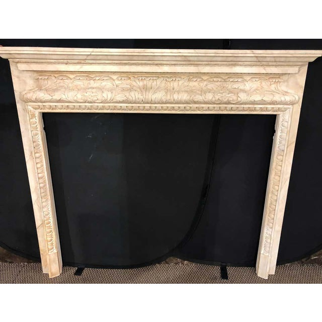 Swedish painted and distressed decorated fire surround in faux marble finish. This fine custom quality fire place surround...