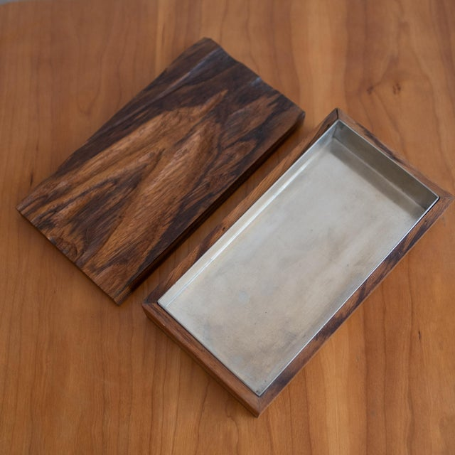 Handcrafted wood box with metal tray by Robert Trout. The carved wood top has a great texture. Signed and dated on the...