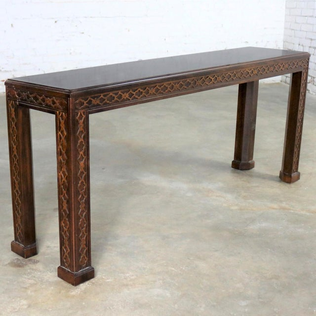 Handsome Chinese Chippendale Chinoiserie Style console table or sofa table with a dark mahogany and walnut finish and...