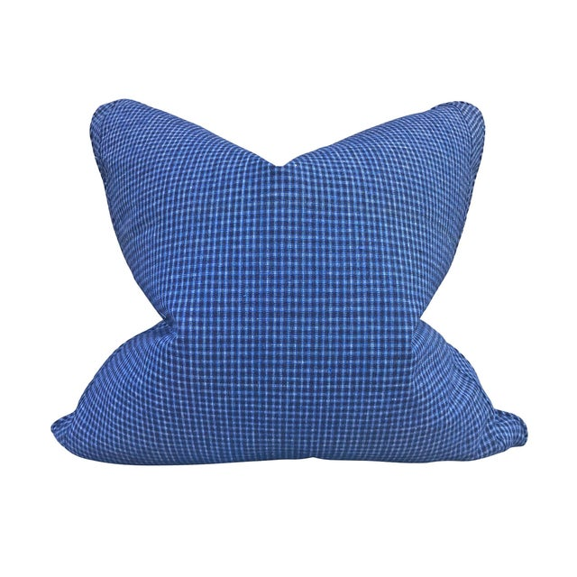 A pair of pillows made from vintage 20th century Chinese cotton panels with a blue plaid pattern on one side, and a...