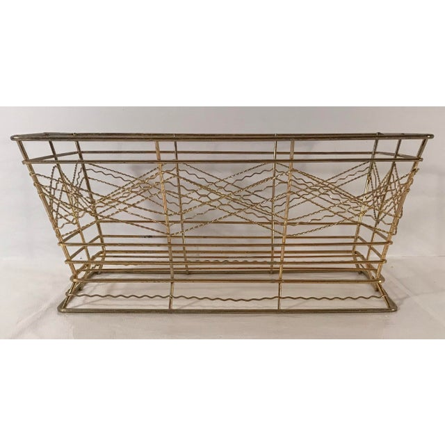 I really like the mid century modern design of this gold metal basket. Many uses for this!