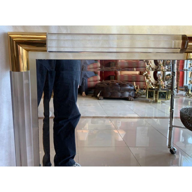 Mid Century Modern Lucite Mirror in the stye of Charles Hollis Jones. Square bevelled mirror floating in a frame of...
