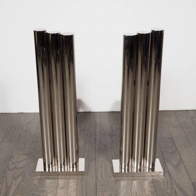 Handmade by our bespoke atelier in New York, this stunning and graphic skyscraper style pair of tubular andirons embodies...