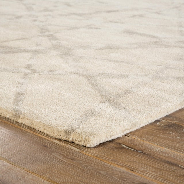 This Nikki Chu hand-tufted area rug boasts a quintessentially modern abstract design, capturing intrigue with intersecting...