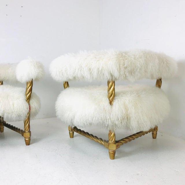 Pair of Mongolian lamb chairs with twisted rope frames with a Hollywood Regency flair.