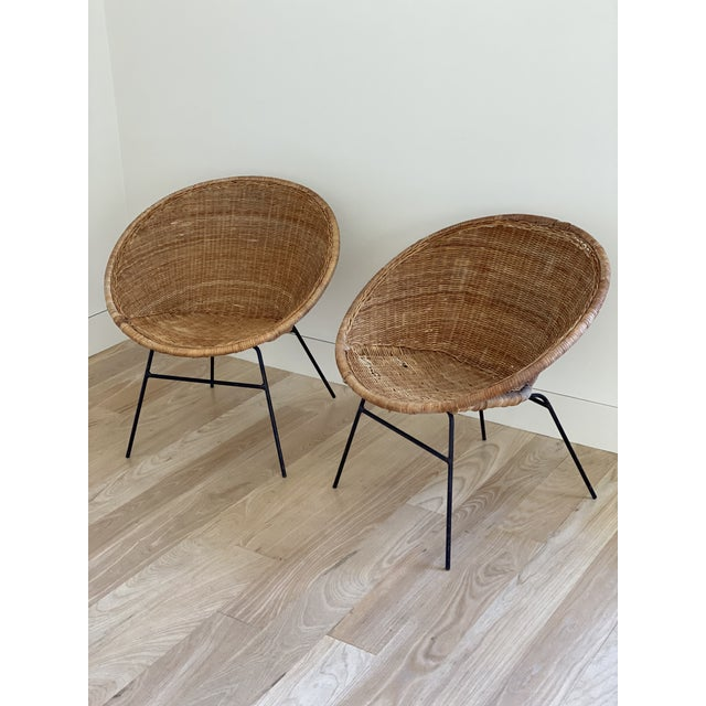 1970's French wicker basket chairs with metal bases, in vintage condition. These have significant wear, but adds to the...