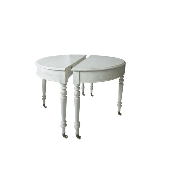 This pair of Swedish white painted early 20Th c. Demi-lunes can come handily together to make a round table. Original...