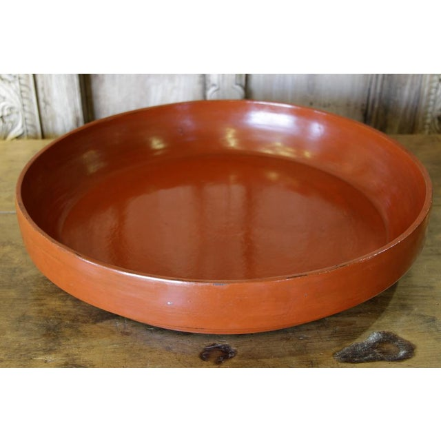 This vintage Tibetan wood plate with features its original red finish. Originally used by monks in Tibetan temples to hold...