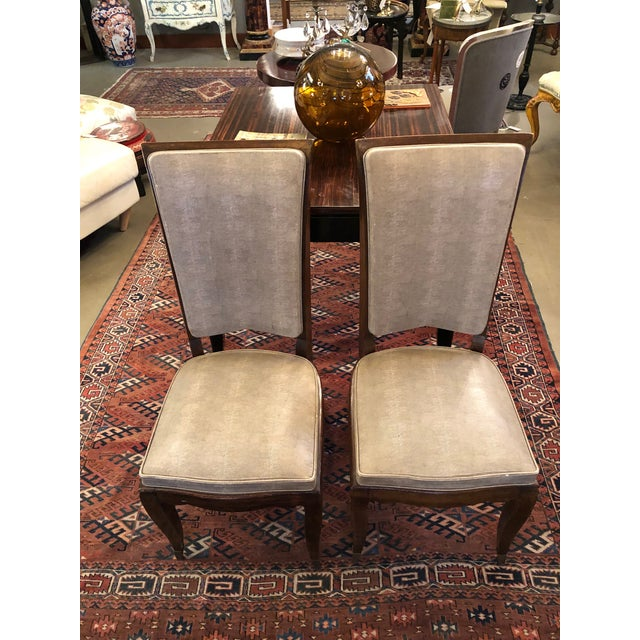 Pair of French Art Deco 1930s Mahogany and Faux Shagreen Dining Chairs. Elegant lines and very well made. The finish has...