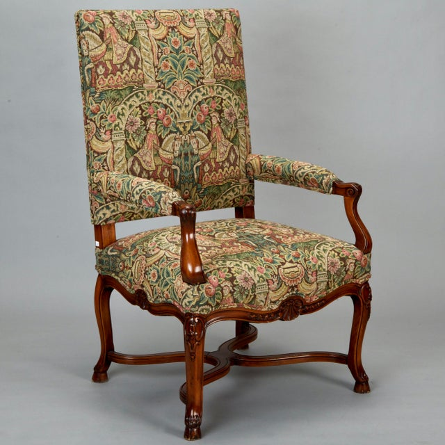 Generously sized 19th century French Louis XIV armchair has beautifully carved details and has been newly upholstered in...