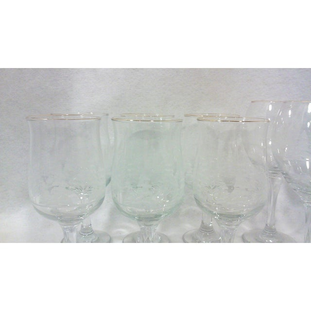 """A set of ten wine and water goblets with white winter trees and a 24k gold rim. Balloon wine glasses-7.75""""H x 3.5""""W Water..."""