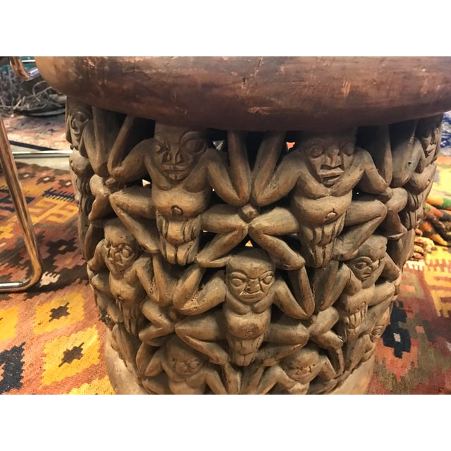 This is a beautifully hand-carved wooden table/stool, by the Bamileke Tribe of Africa. The sides are pierce-cut, relief...