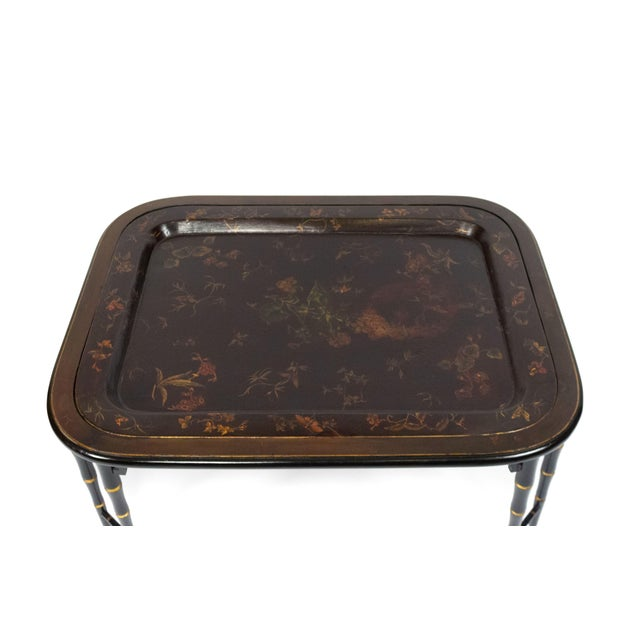 English Regency style (19/20th Cent) brown lacquered tray top coffee table with decorative floral design and inset in a...