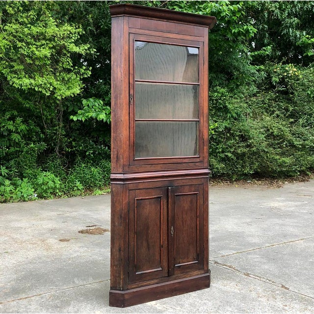 19th Century French Louis Philippe Corner Cabinet takes advantage of normally unused corner spaces and turns them into...
