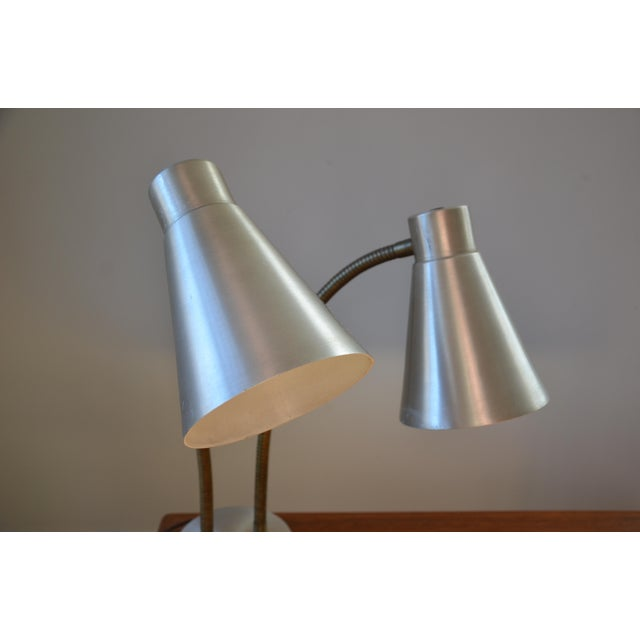 A very nice Mid-Century double gooseneck desk lamp in a silvery gold tone with a multi position switch on base. Switch...