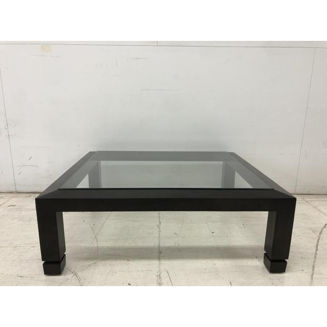 The Dani Large Cocktail Table is a first quality showroom sample that features a Khaviar finish.