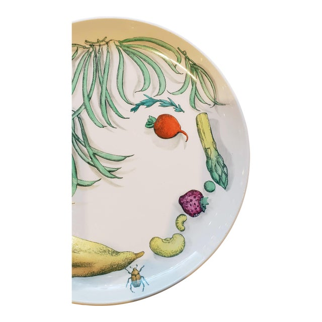 Piero Fornasetti Pottery Vegetalia Plate, #11 Cornettino, 1955. The plate depicts a woman's face created by the...