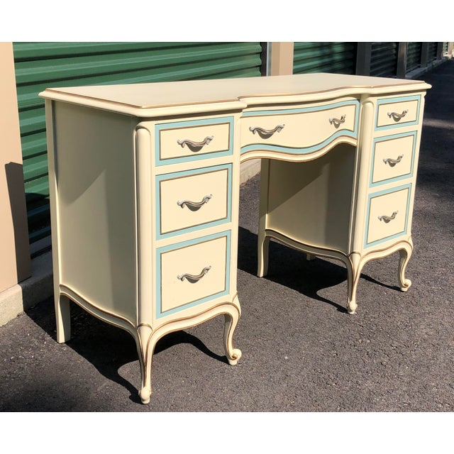 A vintage French provincial style off white and baby blue desk or vanity with dovetailed drawers by Drexel. Knee hole is...