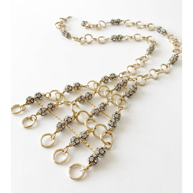 """Gold toned aluminum and rhinestone glam statement necklace, circa 1960's. Necklace measures 22"""" in length, pendant is..."""