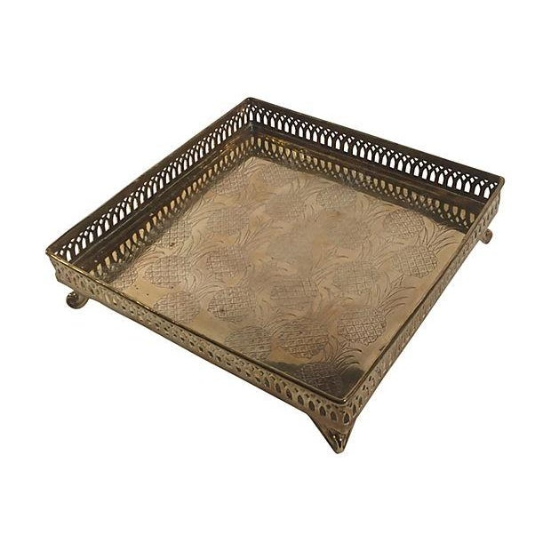 Charm guests with this square brass footed tray with pierced rail and pineapple design, pineapples are well-known for...