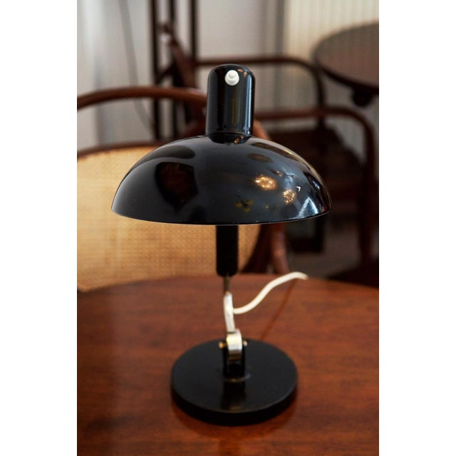 This mid century lamp was designed by Christian Dell and manufactured by Koranda in Vienna in the 1950s. It has a black...