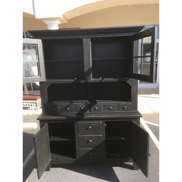 Broyhill is a name synonymous with quality furniture. This large china hutch is matte black with a factory distressed...