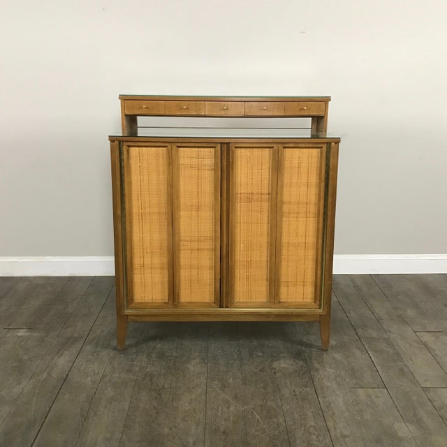 Rare, mid-century modern dry bar cabinet by West Michigan Furniture Company in excellent condition, vintage condition.