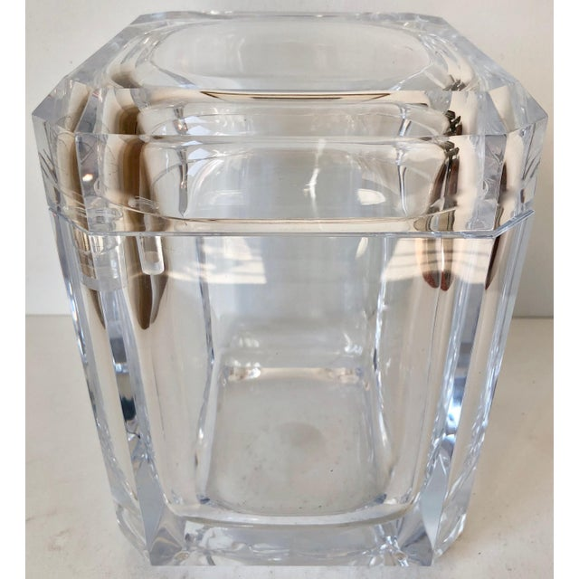 This absolutely gorgeous large, heavy and well-made faceted Italian lucite ice bucket features a swivel top as shown....