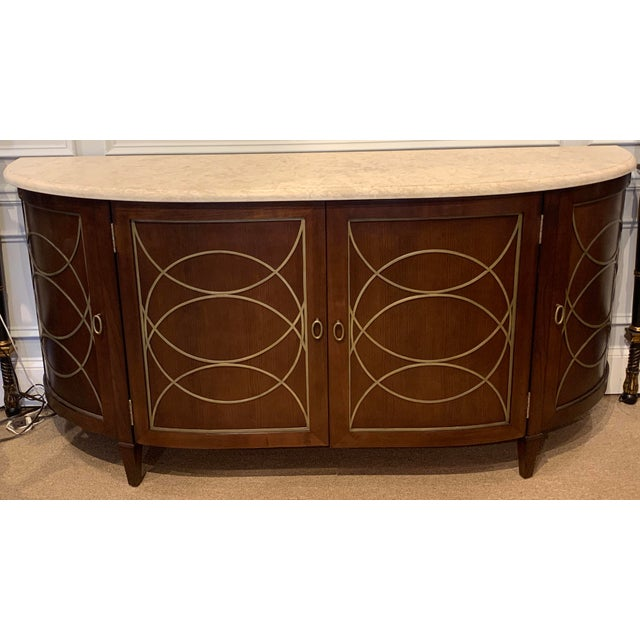 Duchamp Demilune Sideboard with Satillia Marble Top, In the rare custom dark walnut finish with Duchamp Aged Brass...