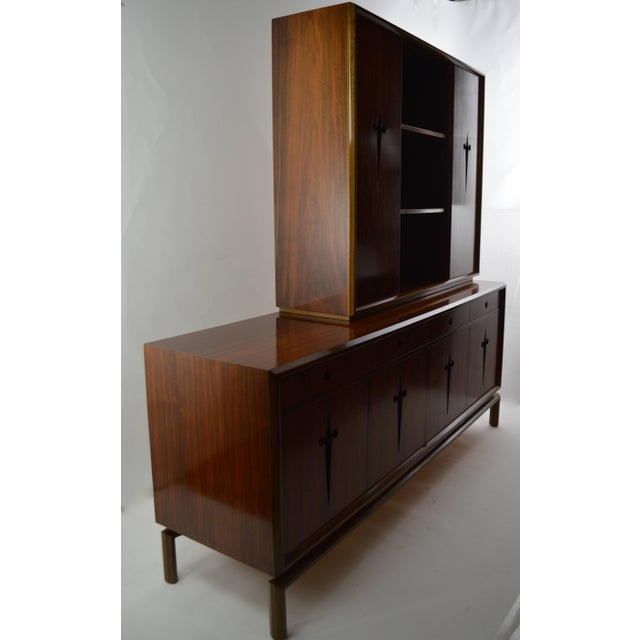 Chic and elegant credenza designed by Edmund Spence. This example is in very good original condition, clean and ready to...