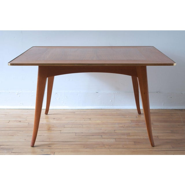 A rare and early square cocktail or coffee table designed by Edward Wormley for Dunbar, circa 1950. Handsome splayed leg...