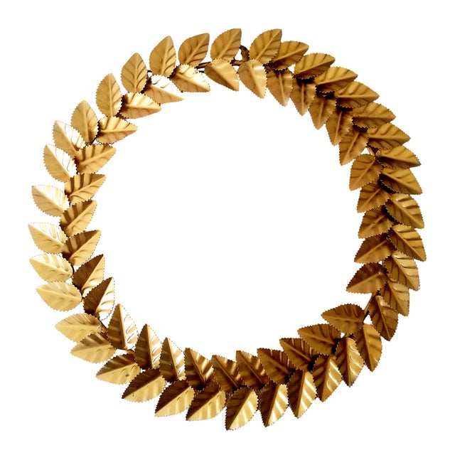 Crown the season with grand ring of metallic leaves, an emblem of peace, honor and glory. Individual metal leaves crafted...