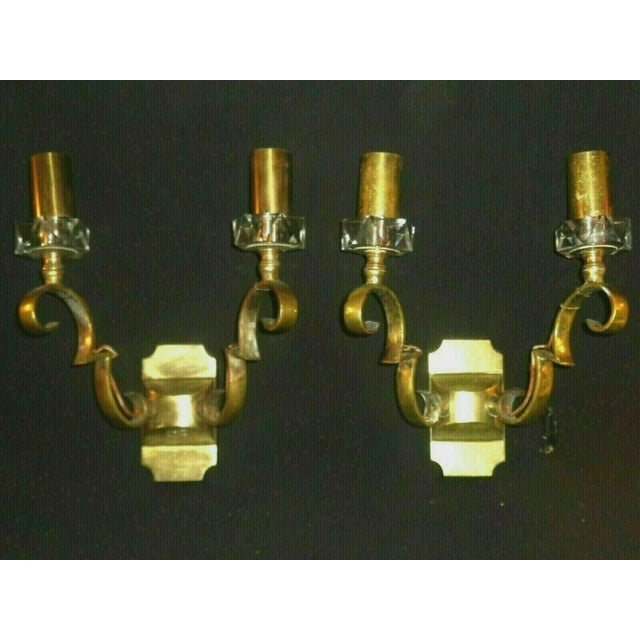 A pair of authentic and Documented French Art Deco Jules Leleu Gilt Bronze with Baccarat Crystal Wall Sconces c1930's....