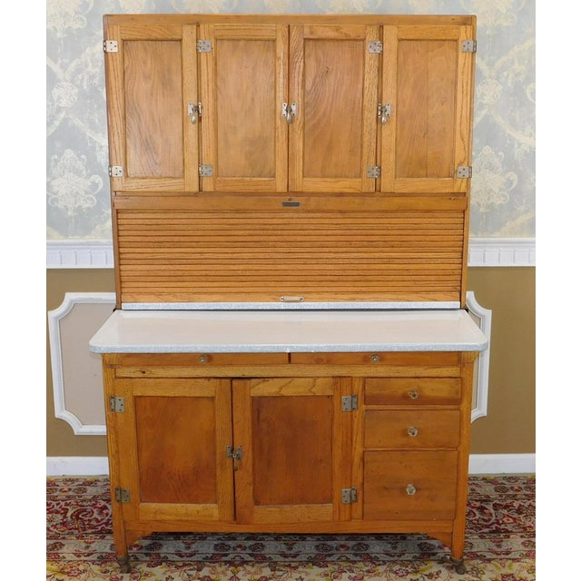 Mint condition antique turn of the century oak Hoosier cabinet made by Sellers of Elwood, Indiana, c1900. Complete cabinet...